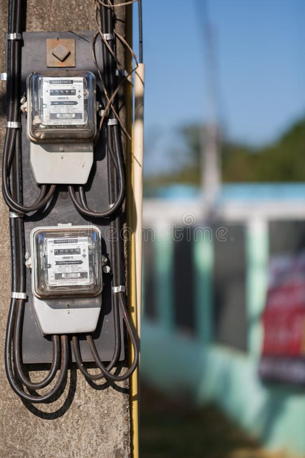 November 15th 2017 Udon Thani Thailand: electricity meter on electricity post in outdoor with blur nature background,The meter is stock photography
