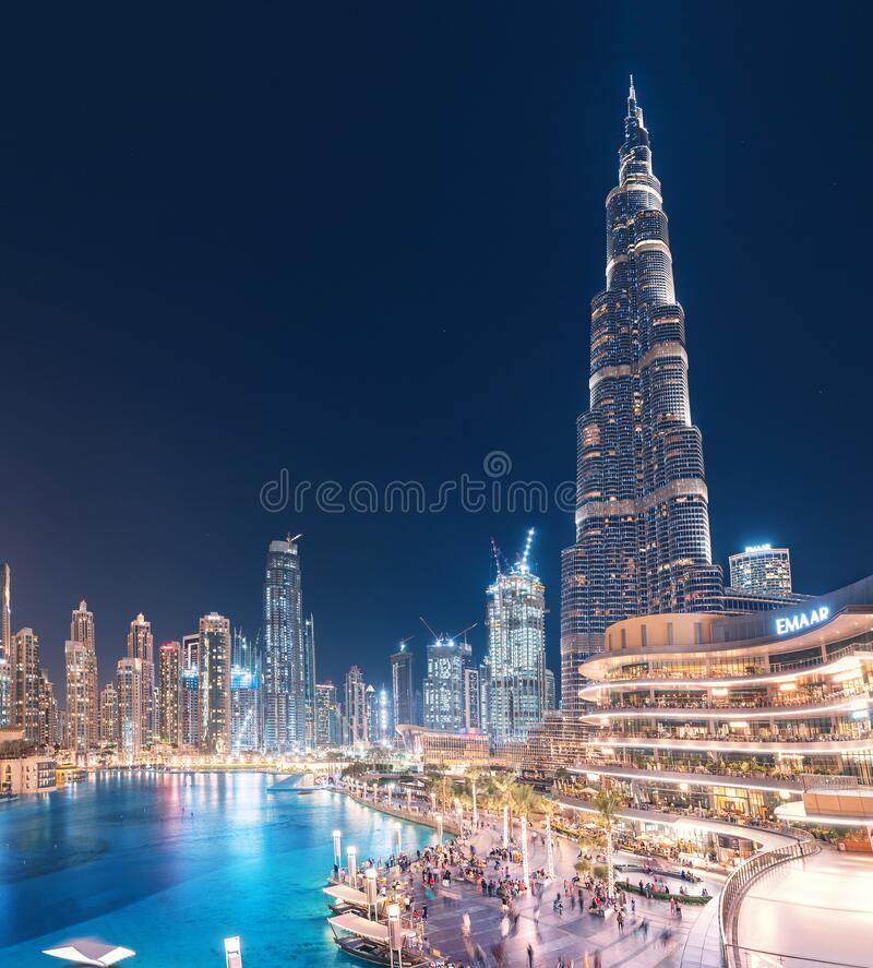 Amazing scenic view of the pool near Burj Khalifa Tallest Buidling and Dubai Mall at night. 26 November 2019, UAE, Dubai: Amazing scenic view of the pool near royalty free stock photography