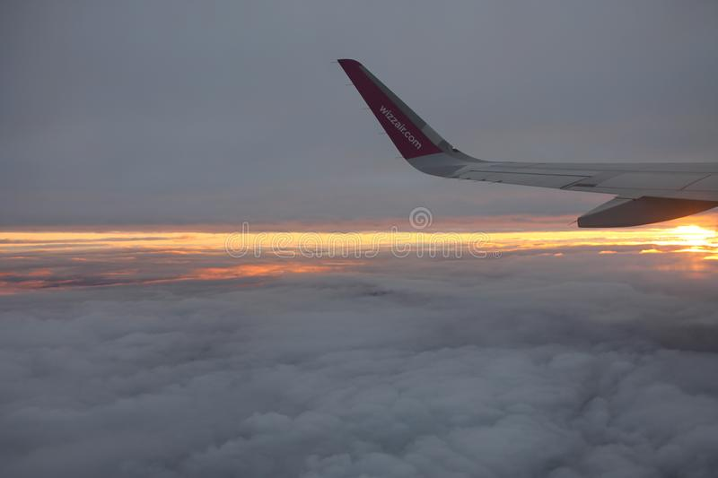 Travelling with Wizzair. Beatiful colorful sunset royalty free stock photography