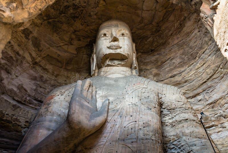 Novembre 2014, Datong, Cina: Statua di Buddha alle grotte di Yungang in Datong, Cina fotografie stock libere da diritti