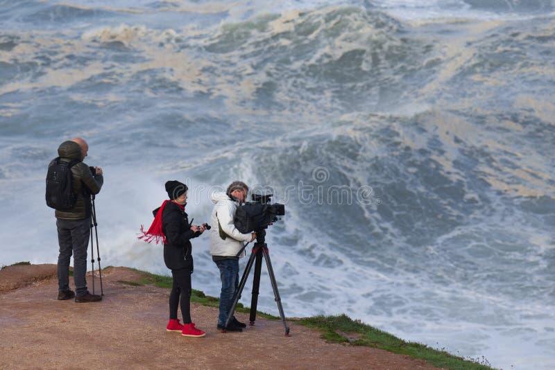 5 Novembro 19 - A videographer and a photographer working in `Praia Norte`, Nazaré,. stock images