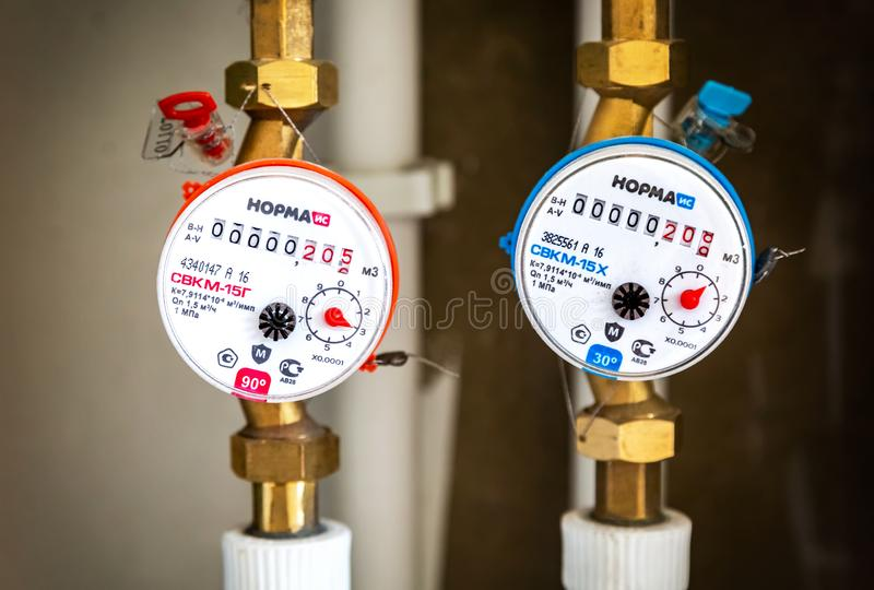 Water meters. Counters of hot and cold water royalty free stock photo