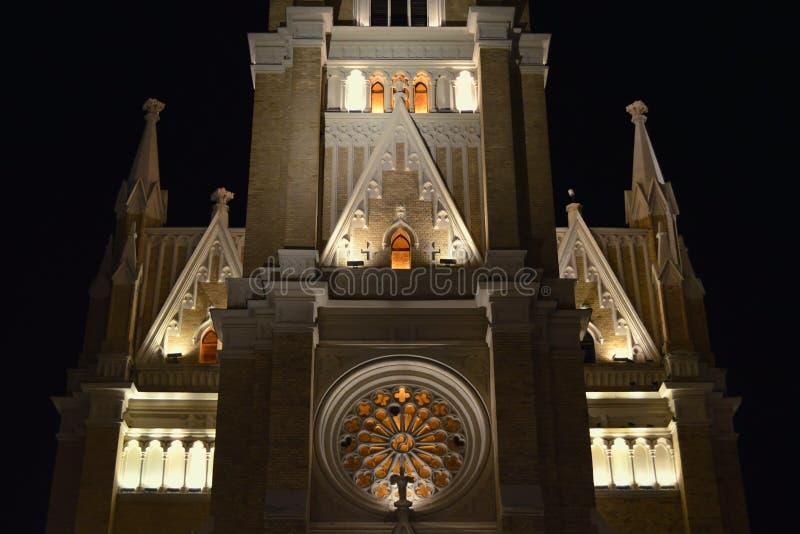Novi Sad - Cathedral. Night Snapshot part Parochial Roman Catholic Church in the name of Mary in the center of Novi Sad, illuminated exterior and interior stock photos
