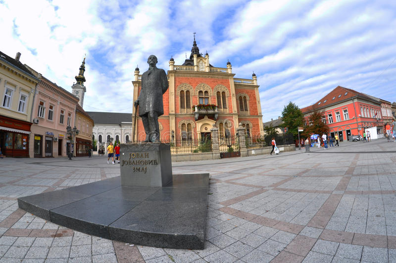 Novi Sad. Monument Serbian poet and writer Jovan Jovanovic called Dragon in Novi Sad. In the background we see an object called Mountain Palace royalty free stock image