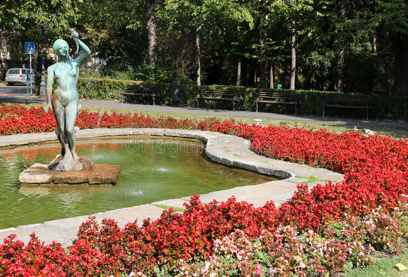 Novi Sad, Serbia. City in the region of Vojvodina. Flowers and fountain in the park royalty free stock image