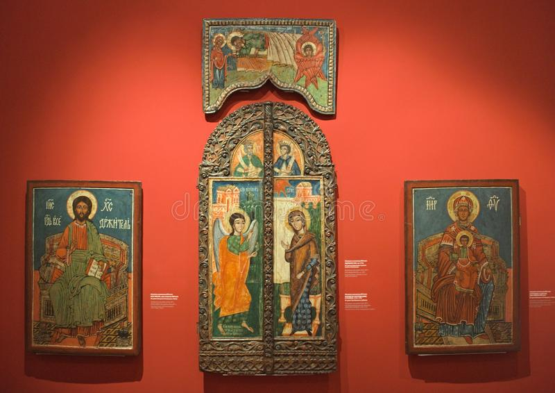 NOVI SAD, SERBIA - April 13th: Wooden Christian icons on red wall in museum stock photography