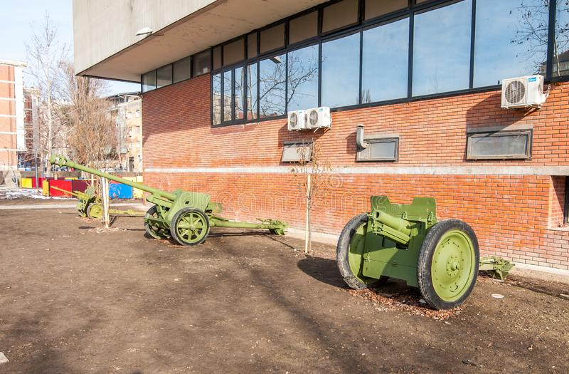 Old army Cannons used by Serbian military in the World war one WWI in front of the museum for tourist historical exhibits. Novi Sad, Serbia. February - 01. 2019 royalty free stock photos
