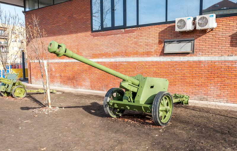 Old army Cannons used by Serbian military in the World war one WWI in front of the museum for tourist historical exhibits. Novi Sad, Serbia. February - 01. 2019 royalty free stock photo