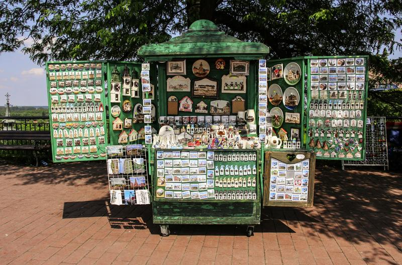 NOVI SAD, SERBIA- JUNE 07, 2019: Wooden stall with souvenirs in the form of magnets, mugs and plates and figures on the territory. Of Petrovaradin Fortress stock photos
