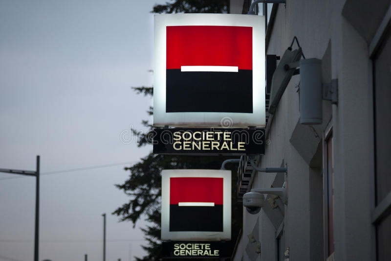 NOVI SAD, SERBIA - MARCH 11, 2017: Logo of the Societe Generale Srbija Bank illuminated in the evening on a branch Novi Sad, Serbi royalty free stock image
