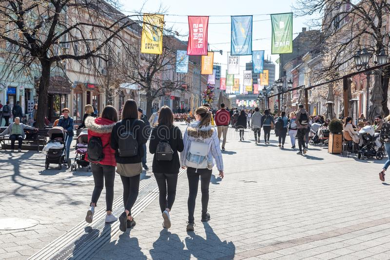 People on the street of Novi Sad Serbia city center on the sunny day walking and enjoying in the nice weather. stock photo