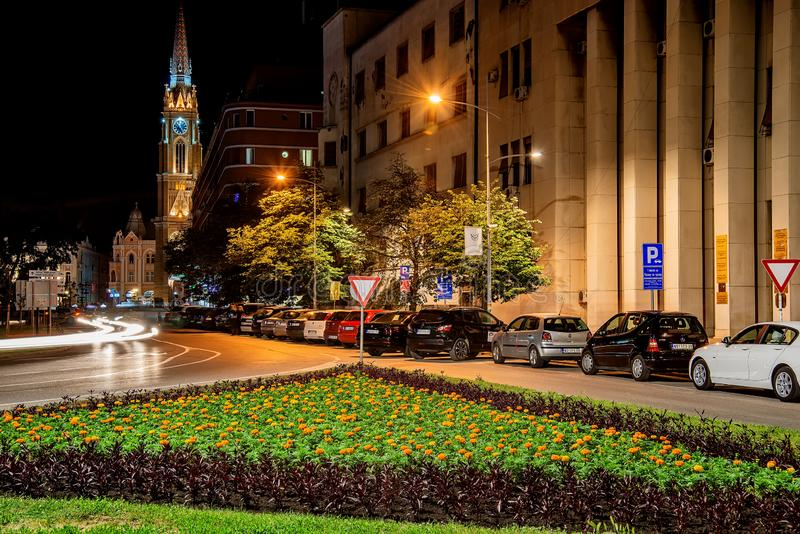 Novi Sad streets at night. Night view of the Liberty Square Trg. Slobode with Mary Church, touris royalty free stock photos