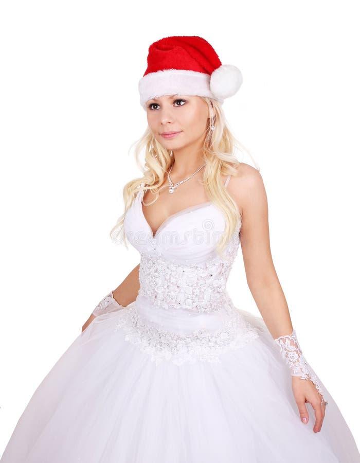 Novia hermosa con el sombrero de Santa aislado en blanco imágenes de archivo libres de regalías