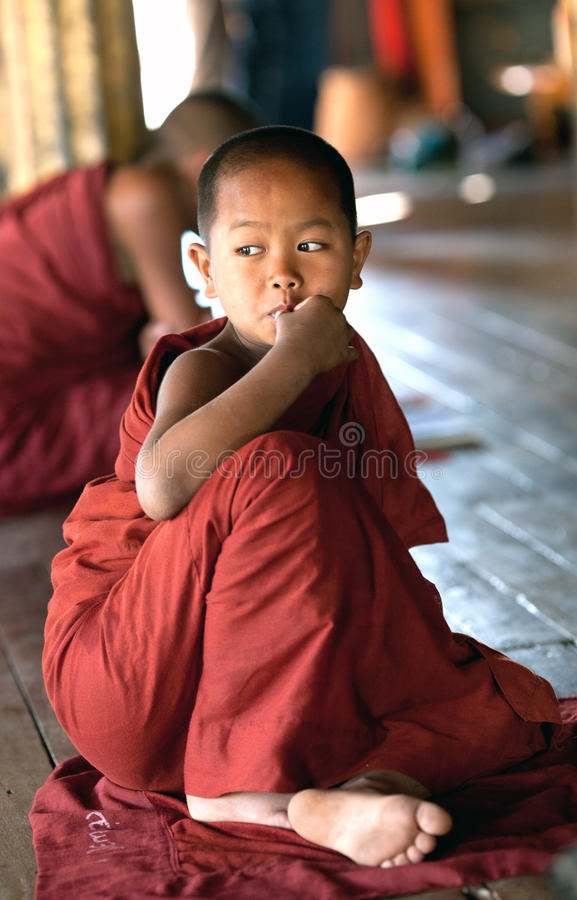 Novice Monk, Myanmar. NYAUNG SHWE, MYANMAR - JANUARY 16: Novice monk learning in the Shwe Yan Pyay monastery school on January 16, 2011 in Nyaung Shwe, Myanmar royalty free stock photo
