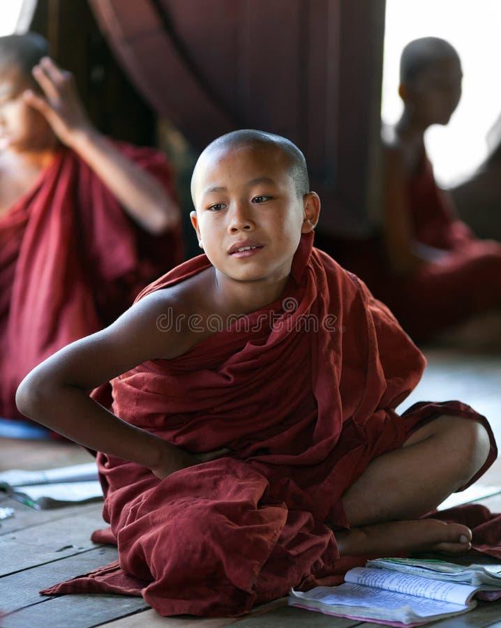 Novice Monk, Myanmar. NYAUNG SHWE, MYANMAR - JANUARY 16: Novice monk learning in the Shwe Yan Pyay monastery shcool on January 16, 2011 in Nyaung Shwe, Myanmar royalty free stock photography
