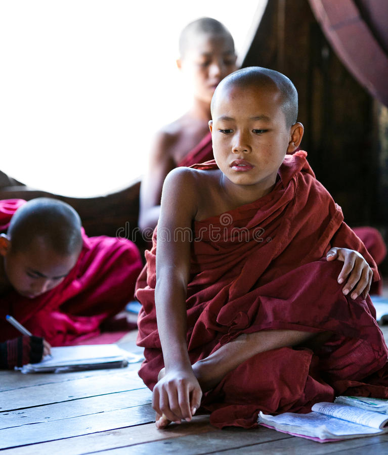 Novice Monks, Myanmar. Novice monks learning together in class room of Shwe Yan Pyay monastery school on January 16, 2011 in Nyaung Shwe, Myanmar stock photos