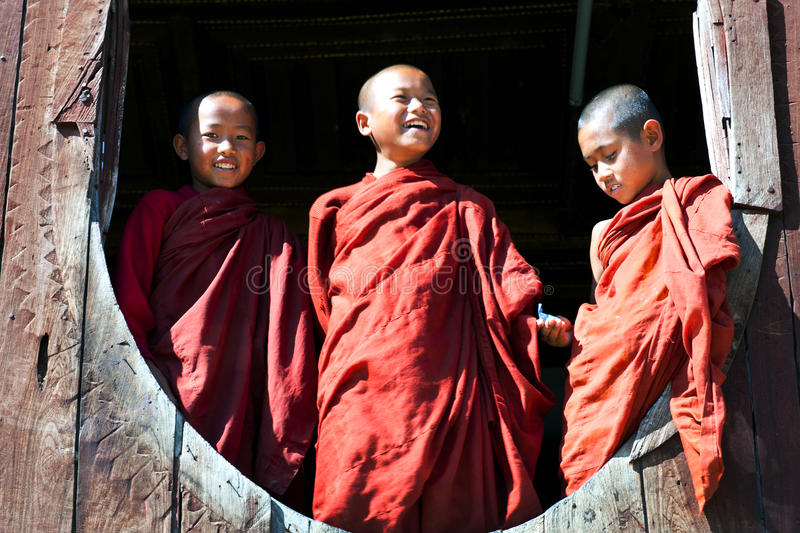 Novice monks. Myanmar. NYAUNG SHWE, SHAN STATE, MYANMAR - JANUARY 13: Novice monks learning together in famous Shwe Yan Pyay Monastery on January 13, 2012 in stock photo