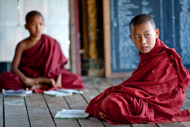Novice Monks in Myanmar. Two novice monks learning in a class room of Shwe Yan Pyay monastery school on January 16, 2011 in Nyaung Shwe, Myanmar stock photos