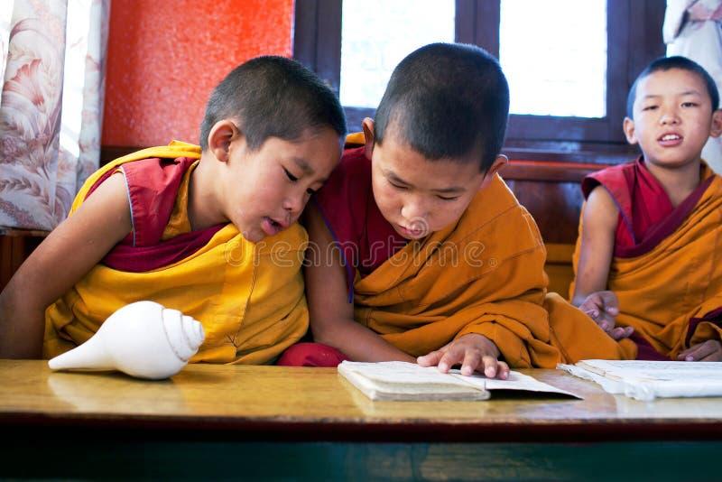 Novice monks, Nepal. KATHMANDU, NEPAL - NOVEMBER 08: Novice monks learning in Swayambhunath monastery school on November 08, 2009 in Kathmandu, Nepal royalty free stock images