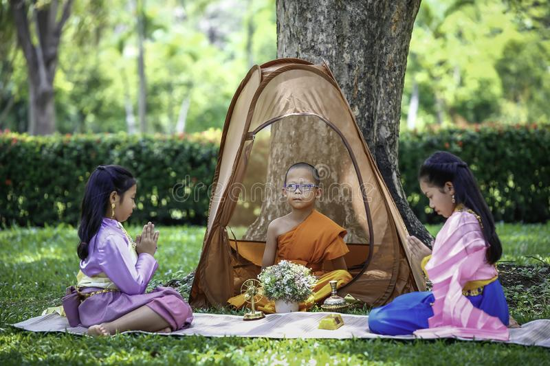 Novices are acting fairly and two girls are listening to Dharma. stock photo