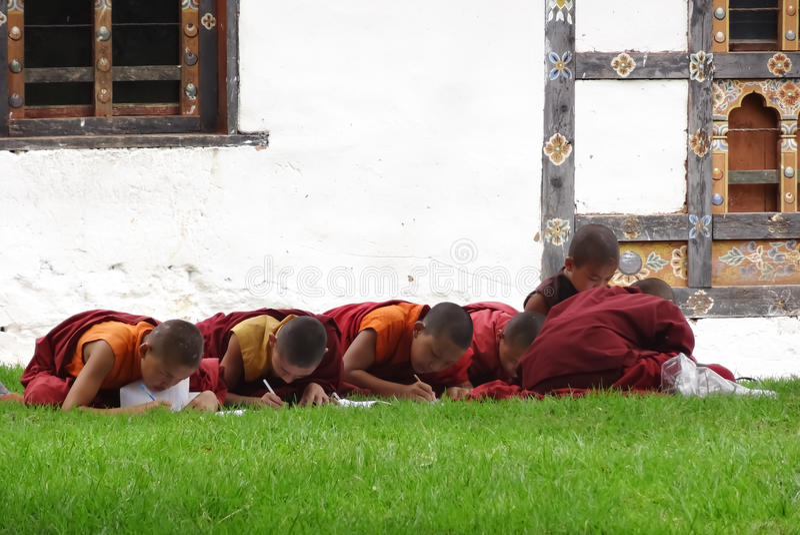 Novices learn. PARO,BHUTAN - SEPTEMBER 4 : Novices learn the teachings of the Buddha on September 4,2013 in Paro,Bhutan stock image