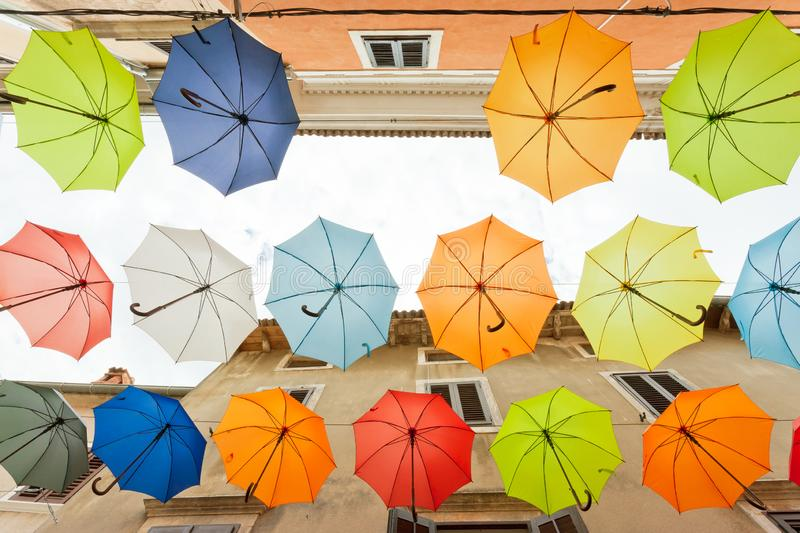 Novigrad, Istria, Croatia - Find the mistake - One umbrella is missing stock photos