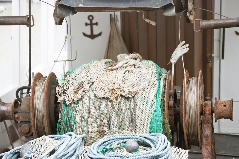 Novigrad, Istria, Croatia - An old fishing net winch on a fishing boat royalty free stock images