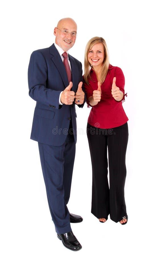 Novo e velho no negócio com polegares acima fotografia de stock royalty free