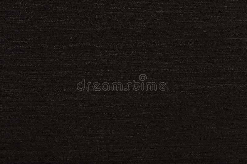 Novo fundo de folheado ebony em preto para sua visão exterior Textura de madeira de alta qualidade fotos de stock royalty free