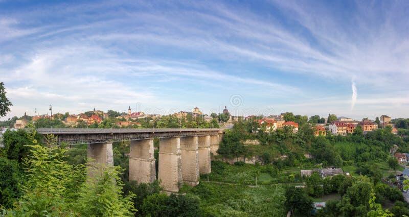 Novoplanovsky bridge over canyon and Old town, Kamianets-Podilskyi city, Ukraine royalty free stock images