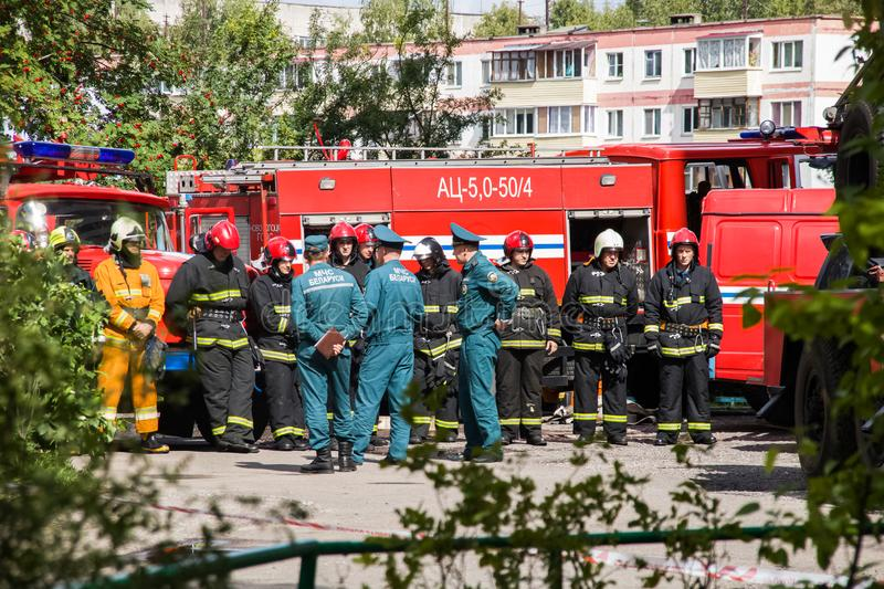 Novopolotsk, Belarus - July 15, 2019: Fire engines and workers. In the courtyard of the house royalty free stock images