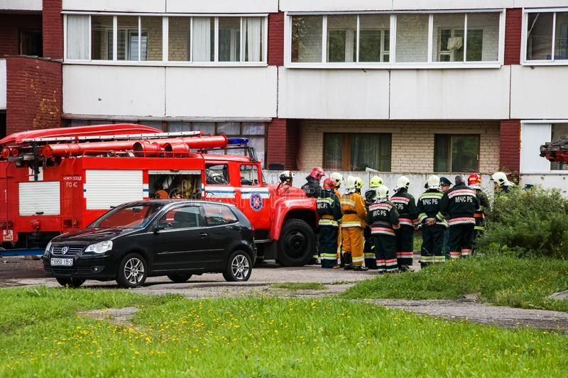 Novopolotsk, Belarus - July 15, 2019: Fire engines and workers. In the courtyard of the house stock photo