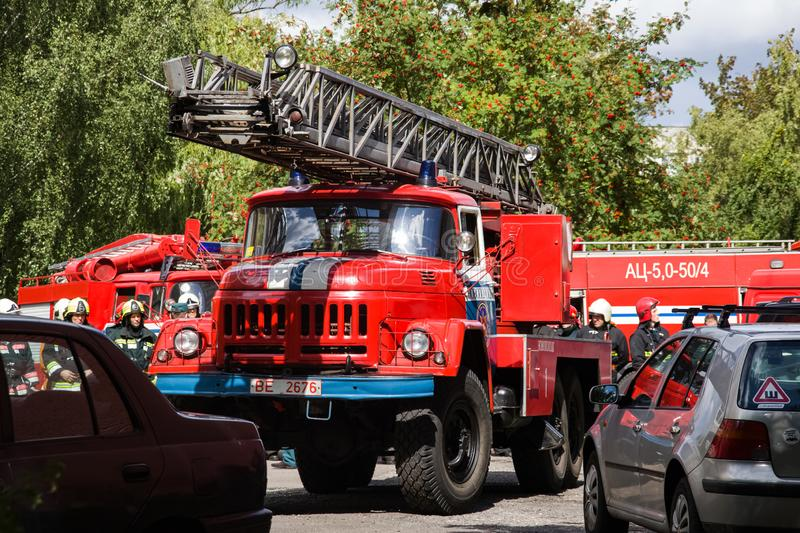 Novopolotsk, Belarus - July 15, 2019: Red fire truck closeup. Among green trees royalty free stock photos