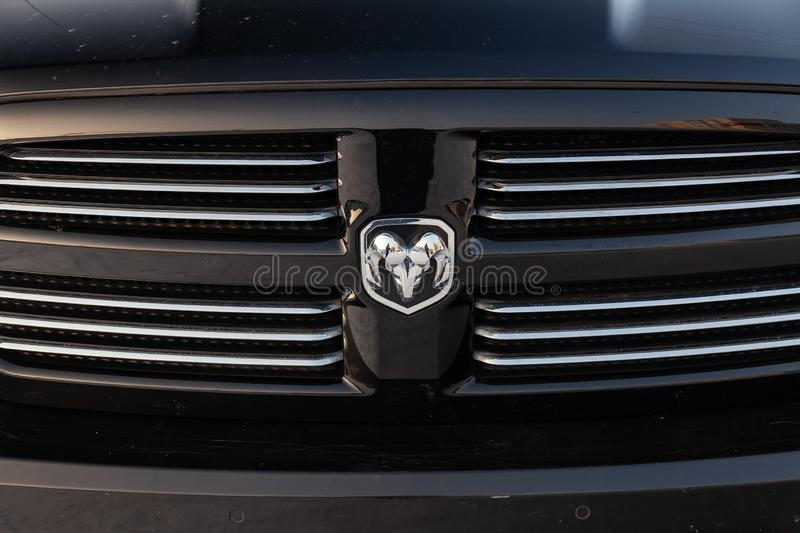 Black Dodge Ram with an engine of 5.7 liters front radiator grille view on the car parking with snow background stock photos