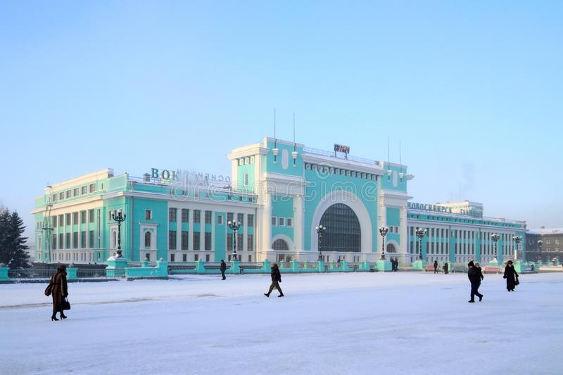 The building of the railway station on a Sunny frosty morning in. Novosibirsk, RUSSIA-DECEMBER 20, 2010: Garin-Mikhailovsky Square and Novosibirsk-Glavny train royalty free stock photography