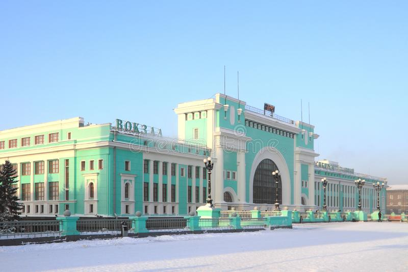 Facade of the railway station building on a Sunny frosty morning. Novosibirsk, RUSSIA-DECEMBER 20, 2010: Garin-Mikhailovsky Square and Novosibirsk-Glavny train royalty free stock image