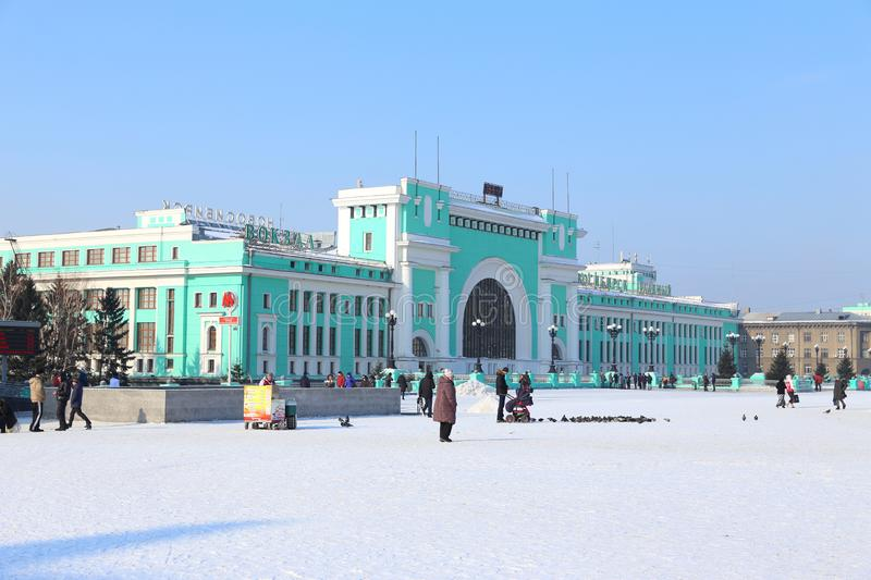 Station square and the townspeople on a Sunny frosty day in Novosibirsk. Novosibirsk, RUSSIA-FEBRUARY 21, 2016: Garin-Mikhailovsky Square and Novosibirsk-Glavny stock images