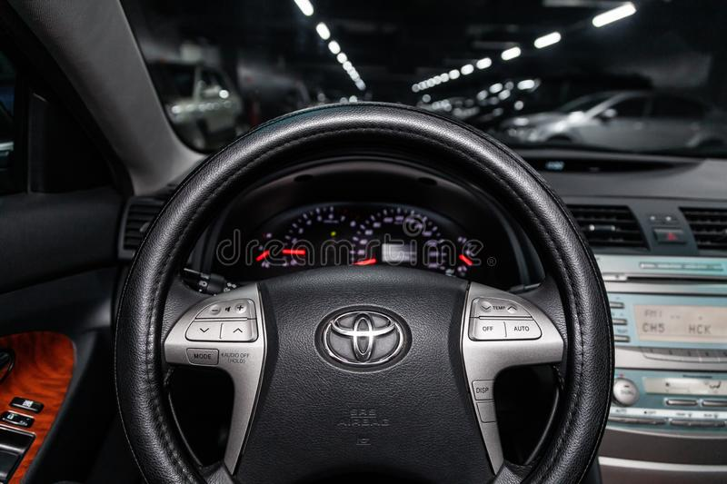 Novosibirsk, Russia - February 15, 2019: Toyota Camry. Close-up of the dashboard, speedometer, tachometer and steering wheel. Photography of a modern car on a stock image