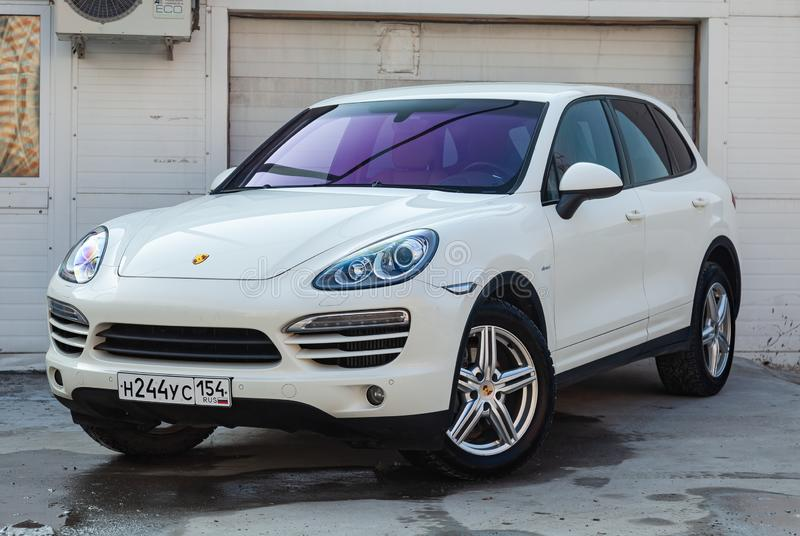 Front view of Porsche Cayenne 958 2008 in white color after cleaning before sale in a summer day on parking background stock photos