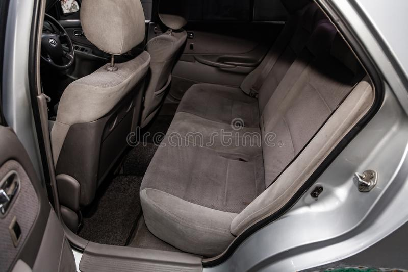 Novosibirsk, Russia June 14, 2019 Mazda Capella. Novosibirsk, Russia – June 14, 2019:  Mazda Capella, close-up of the gray  rear seats with seats belt royalty free stock photography