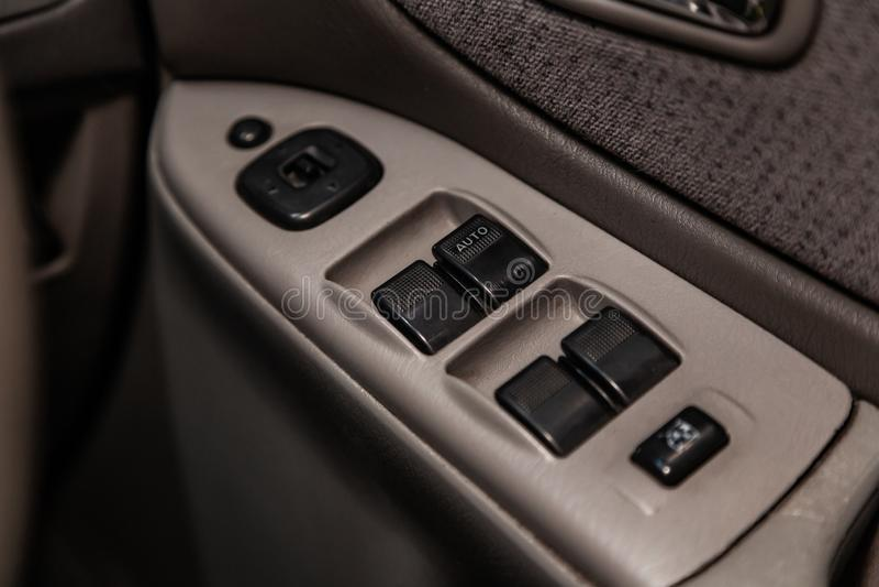 Novosibirsk, Russia June 14, 2019 Mazda Capella. Novosibirsk, Russia – June 14, 2019:  Mazda Capella,  close-up of the side door buttons: window stock photography