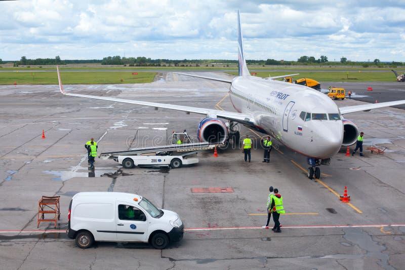 Tolmachevo Airport, ground handling services of airplane Boeing 737-800 named after N. Leskov, Aeroflot Airlines. NOVOSIBIRSK, RUSSIA - June 9, 2019: Tolmachevo royalty free stock image