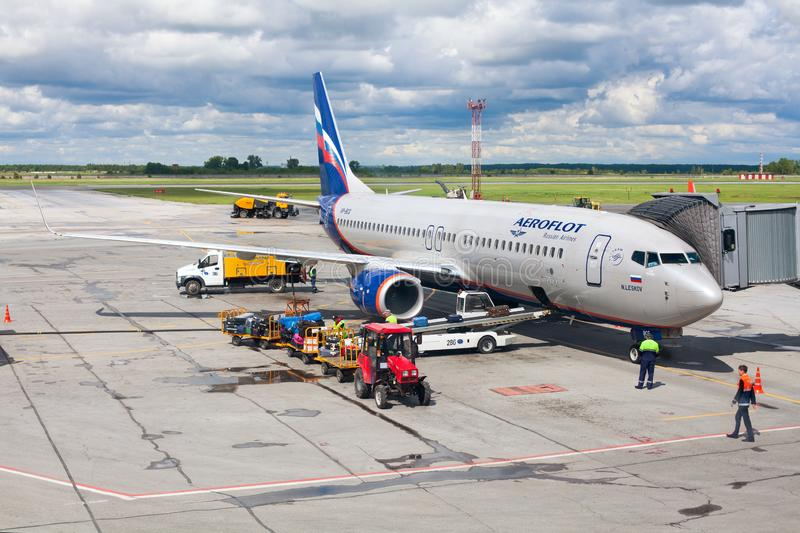 Tolmachevo Airport, ground handling services of airplane Boeing 737-800 named after N. Leskov, Aeroflot Airlines stock photos
