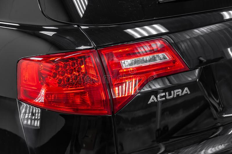 Rear view of used Acura MDX 2008 year black color with red taillamps standing in the light service box of the detailing workshop. Novosibirsk, Russia - 08.01 royalty free stock images