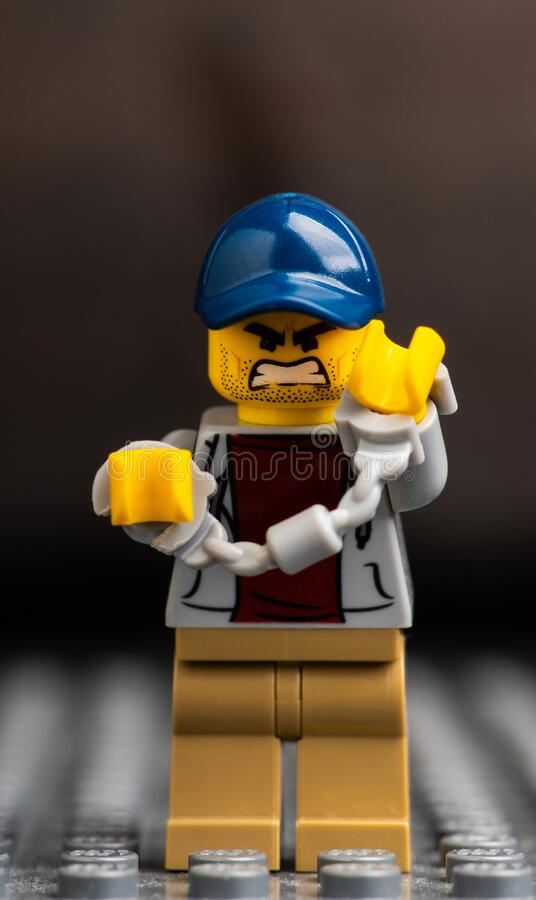 Novosibirsk, Russian Federation - February 4, 2020 Lego minifigure with angry face and locked handcuffs. Macro shot. Selective focus. Shallow depth of field royalty free stock images