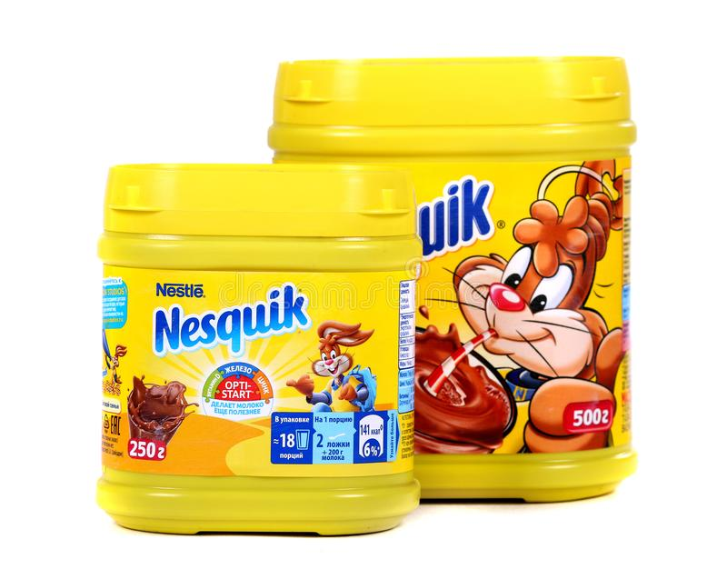 Nestle Nesquik cocoa. Novyy Urengoy, Russia - October 18, 2018: Yellow cans of the Nestle Nesquik cocoa isolated over white background stock photography