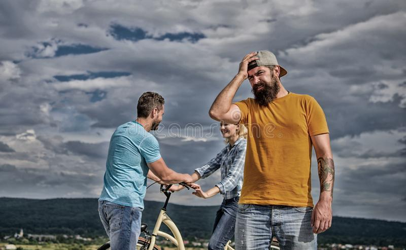 Now she dating with another guy. Hipster regretful face in front of couple in love. Hipster feels jealous and regretful stock image