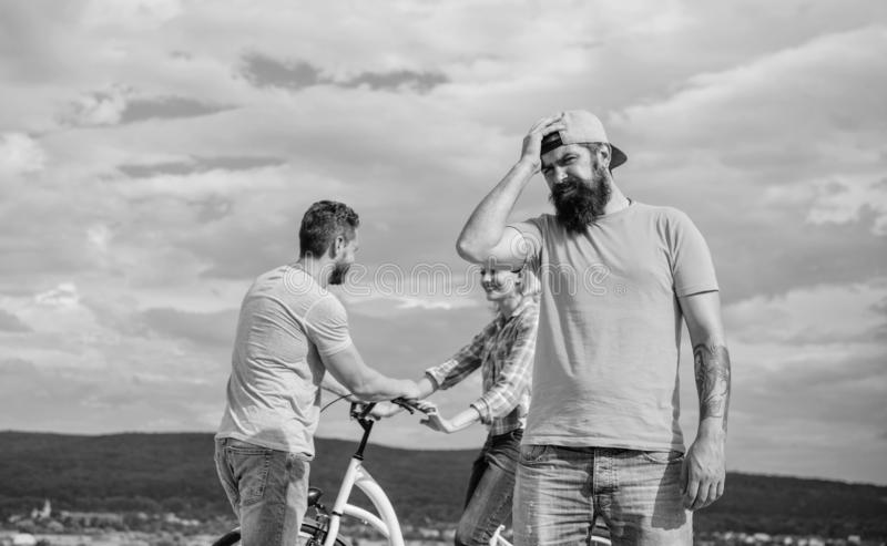 Now she dating with another guy. Hipster regretful face in front of couple in love. Hipster feels jealous and regretful. Man regret not asked her go out. She royalty free stock photos