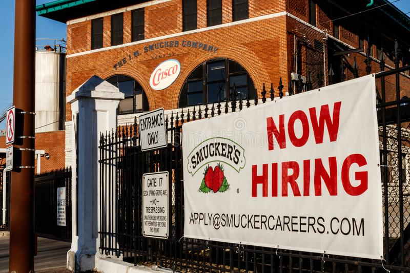 Cincinnati - Circa February 2019: Now Hiring sign at J. M. Smucker Company. Smucker manufactures jams and jellies I. Now Hiring sign at J. M. Smucker Company royalty free stock photo