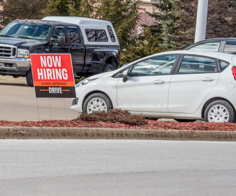 Now Hiring sign stock images